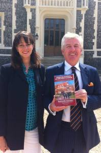 Victoria presents a copy of her book to  Chairman of Governors at Lancing College, Dr Harry Brunjes