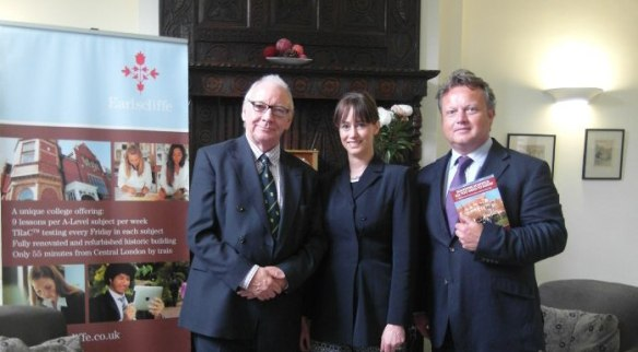 """Victoria and Graham present Mr Tim Fish with a copy of Victoria's new book"""